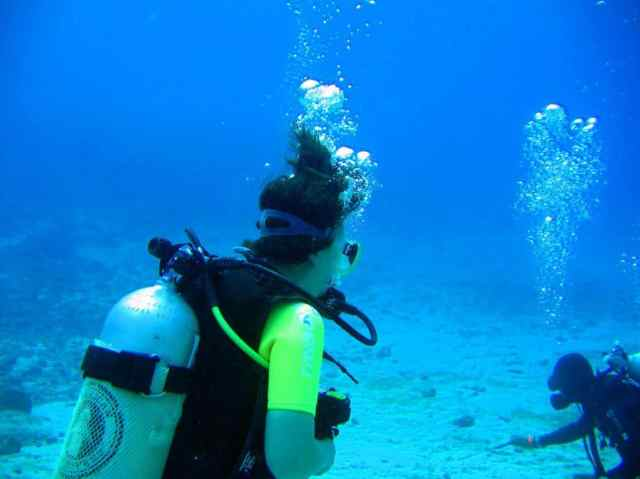 A girl is diving in Derawan