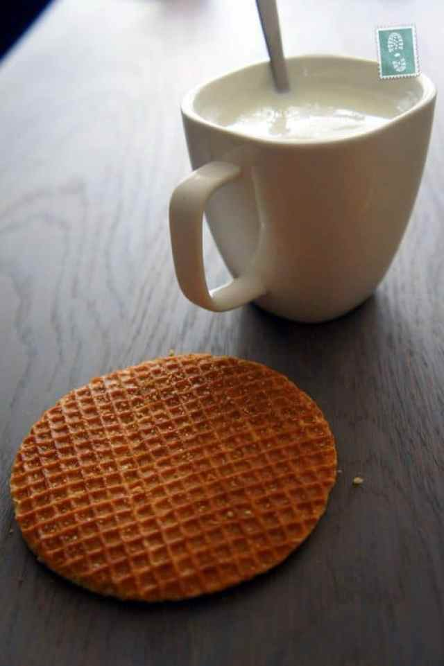 a stroopwafel and a glass of hot milk