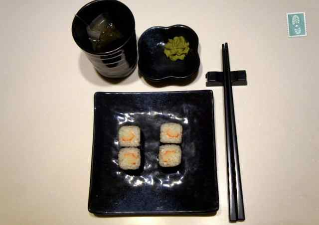A plate, chopsticks and sushi