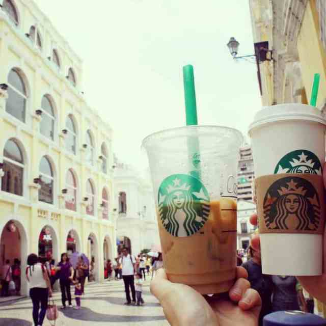 two cups of Starbucks coffee