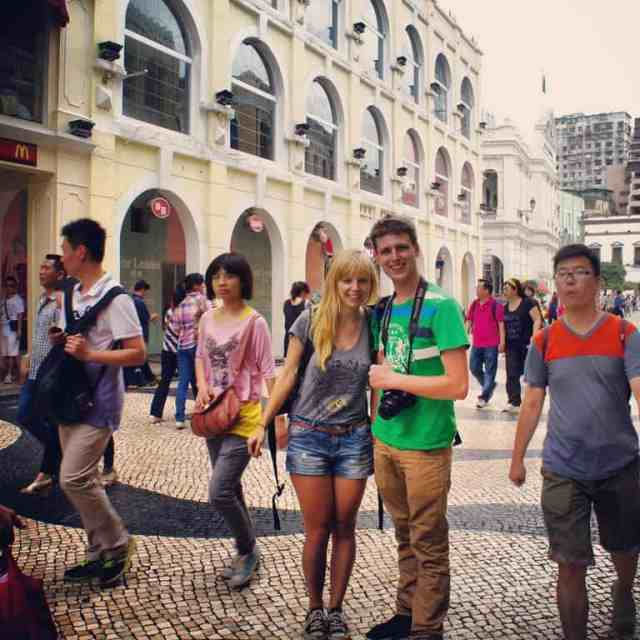 A girl and a boy are at Senado Square