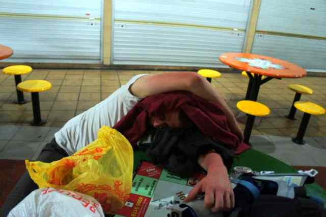 A boy having a nap at Maxwell Hawker Center