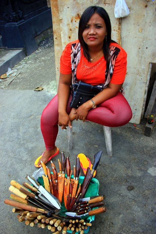 Local woman selling knives in the street