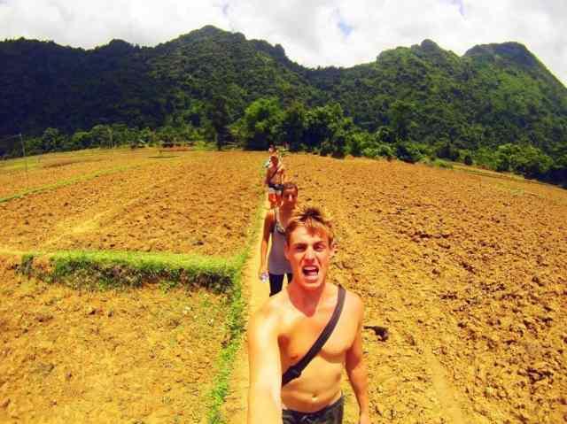 Walking-through-Rice-Paddies,-Vang-Vieng