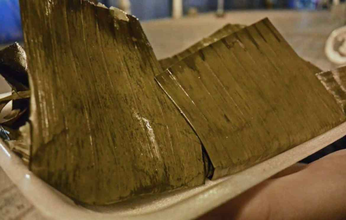 Tamale wrapped in banana leaf