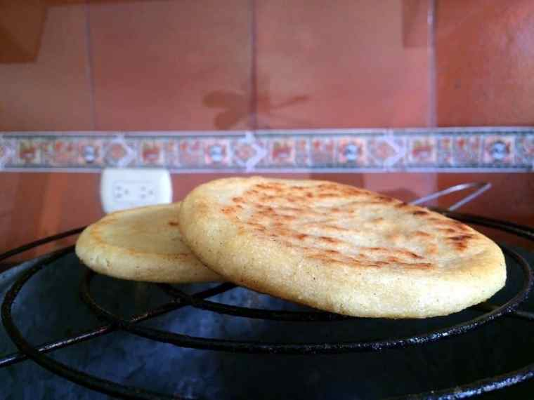 Arepa served for breakfast in Venezuela - it is usually made of ground maize dough or cooked flour.