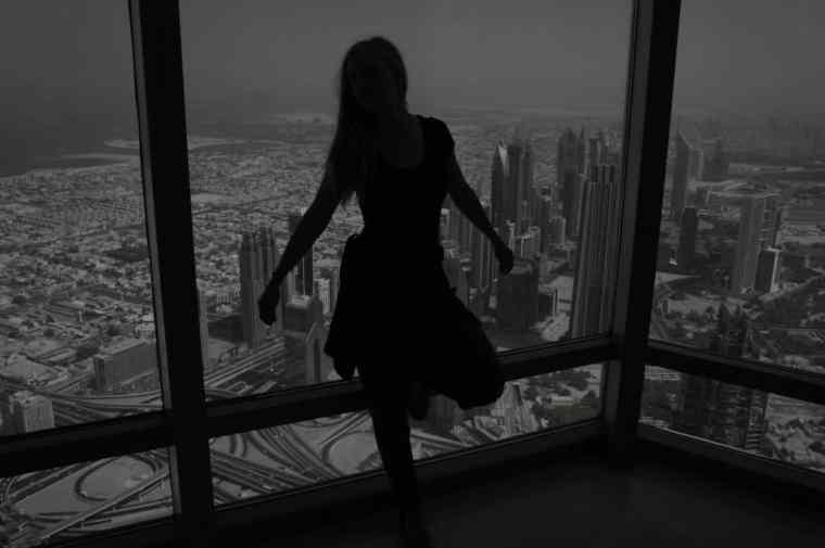 A girl on top of Burj Khalifa.