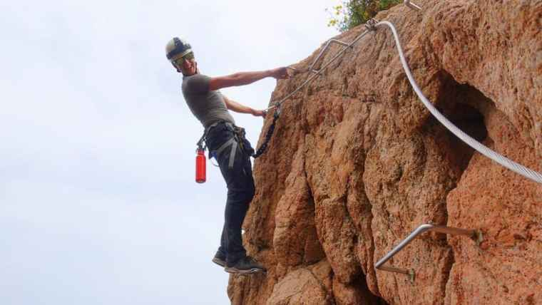 An example of the footholds and steel cable, with some guy lurking about