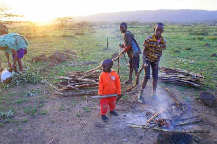 Maasai kids preparing the bonfire.