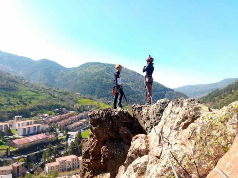King and queen of the castle. At a summit with the view of Ribes de Freser below