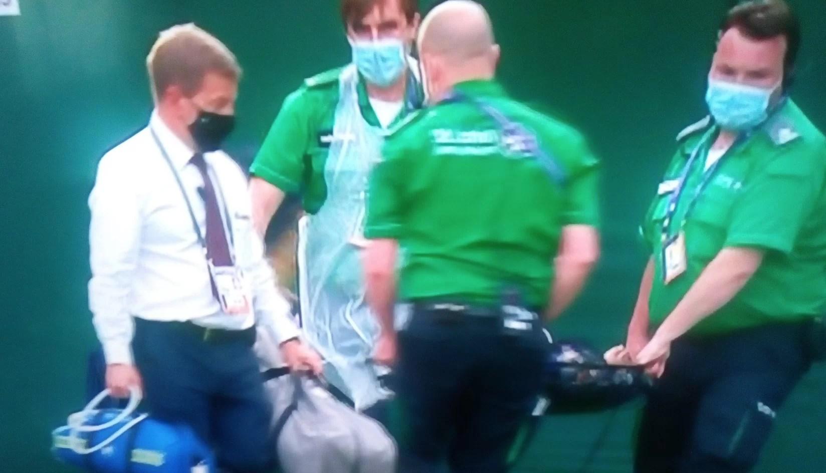 Wimbledon ball kid stretchered off court after slipping on grass | eTrends  News