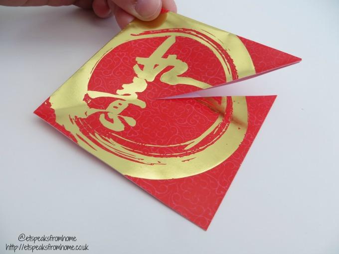 chinese new year ang pow fish cutting
