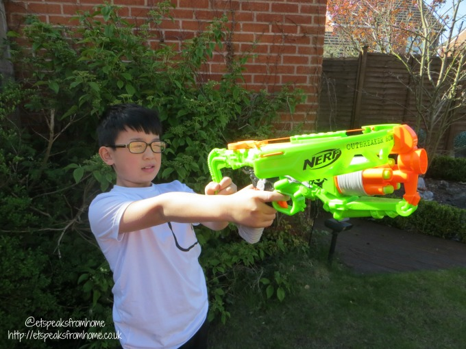 Nerf Zombie Strike Outbreaker Bow shooting