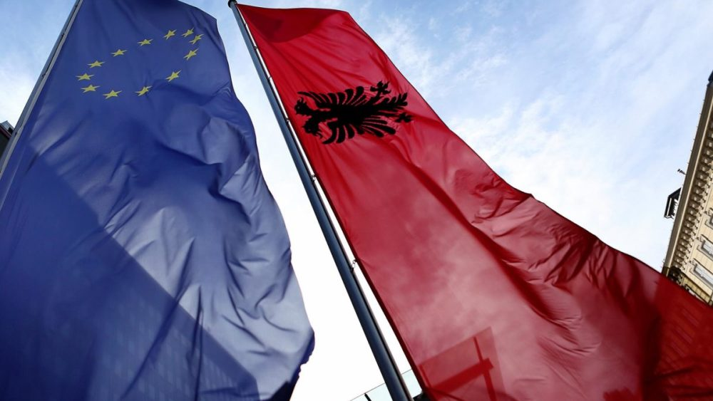 The flags of the EU and Albania side by side