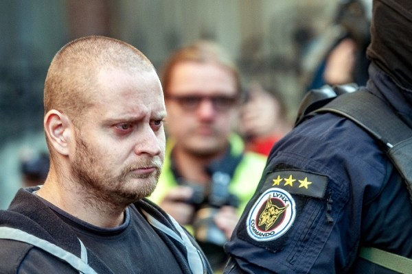 Former soldier Miroslav Marcek, pictured here being taken into custody, has reportedly admitted to the murderr of Slovakian journalist Jan Kuciak and his fiancee