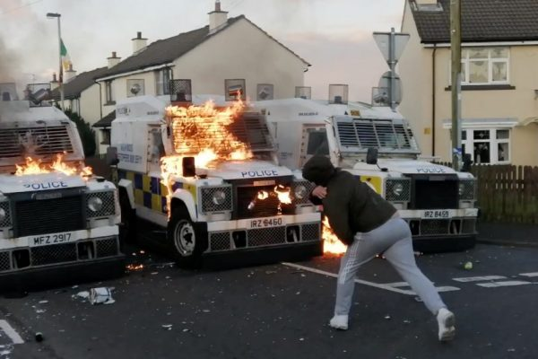 A person throws a petrol bomb at PSNI vehicles after a suspicious package was found in Creggan Heights, Derry, Northern Ireland September 9, 2019.