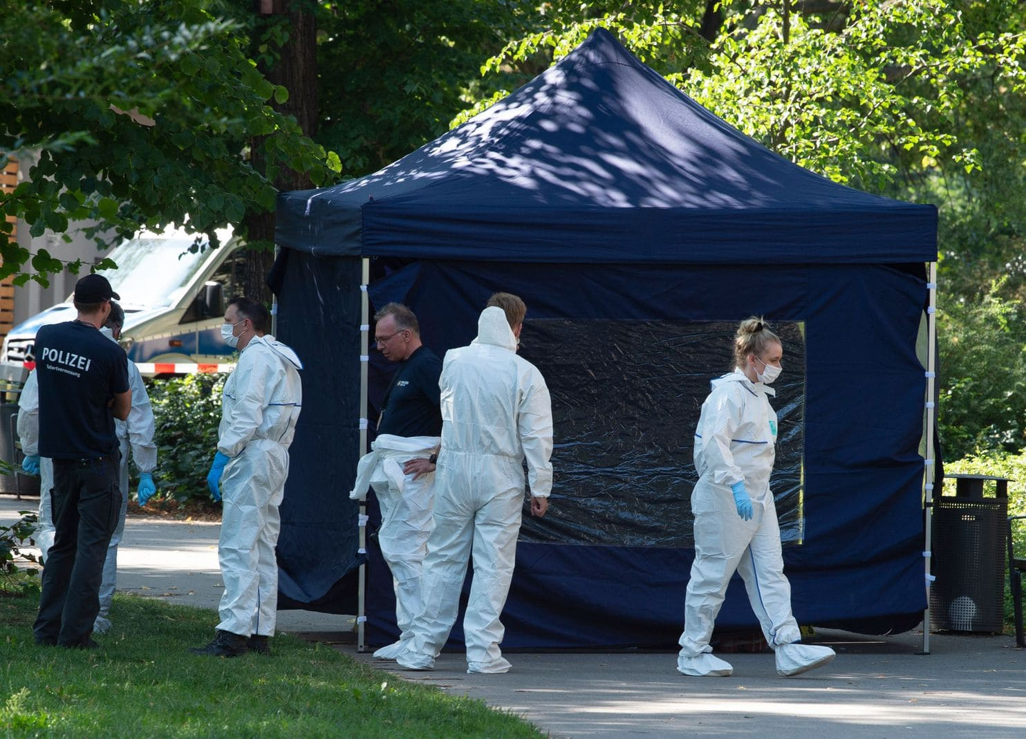 Police and forensics officials at a crime scene in Berlin on Aug. 23. Zelimkhan Khangoshvili of Georgia was fatally shot, and German media outlets suspect Russia was involved in the assassination-style killing.