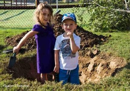 Kids digging g a ditch