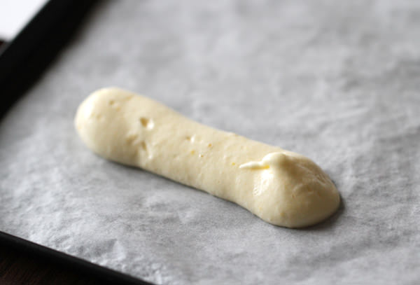 Pipe the batter with a round pastry tip on a parchment-lined baking sheet.