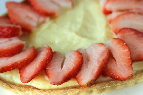 Arrange strawberry slices.