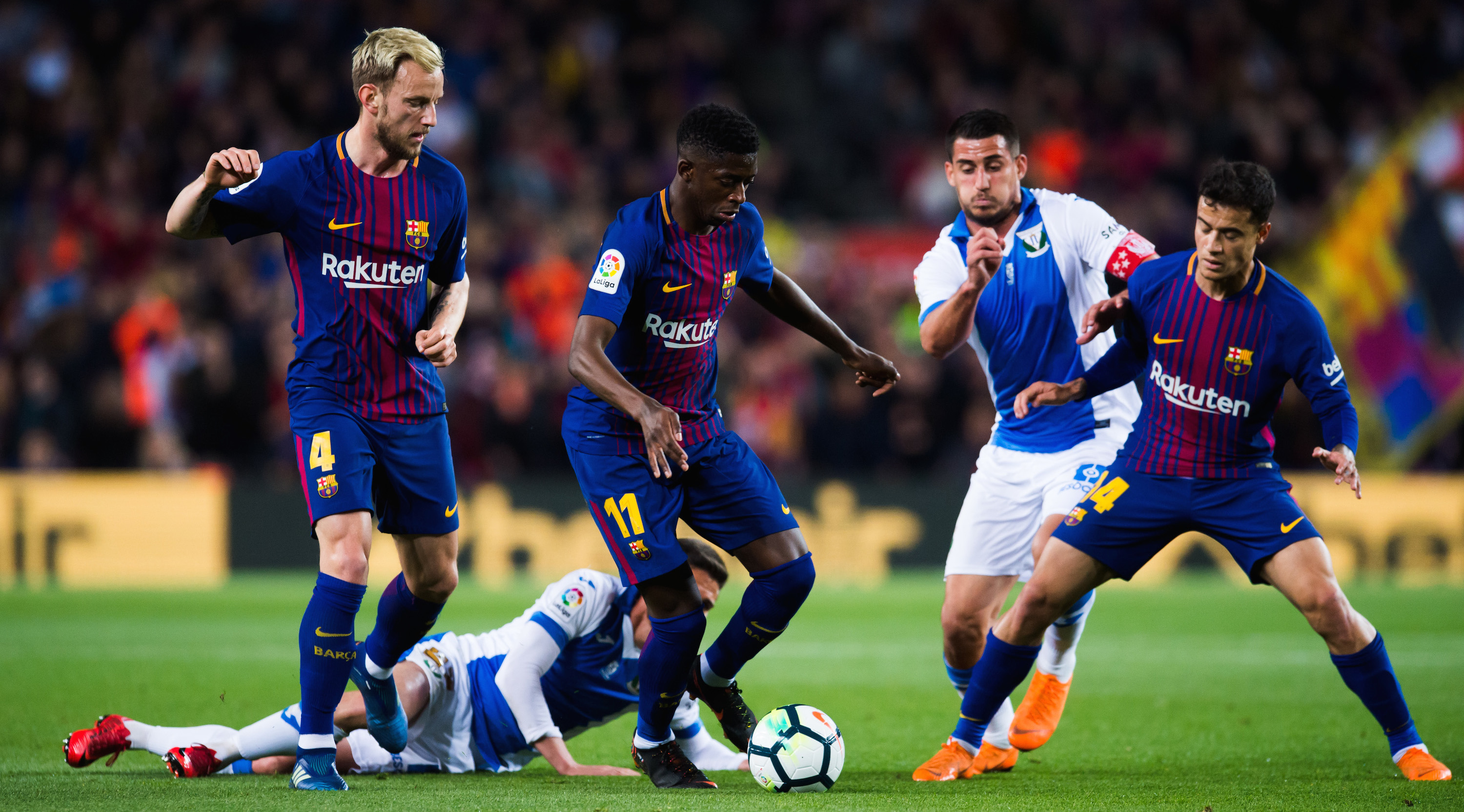BARCELONA, SPAIN - APRIL 07: Ousmane Dembele of FC Barcelona conducts the ball among his teammates Ivan Rakitic and Philippe Coutinho and Gabriel Pires of CD Leganes during the La Liga match between Barcelona and Leganes at Camp Nou on April 7, 2018 in Barcelona, Spain. (Photo by Alex Caparros/Getty Images)