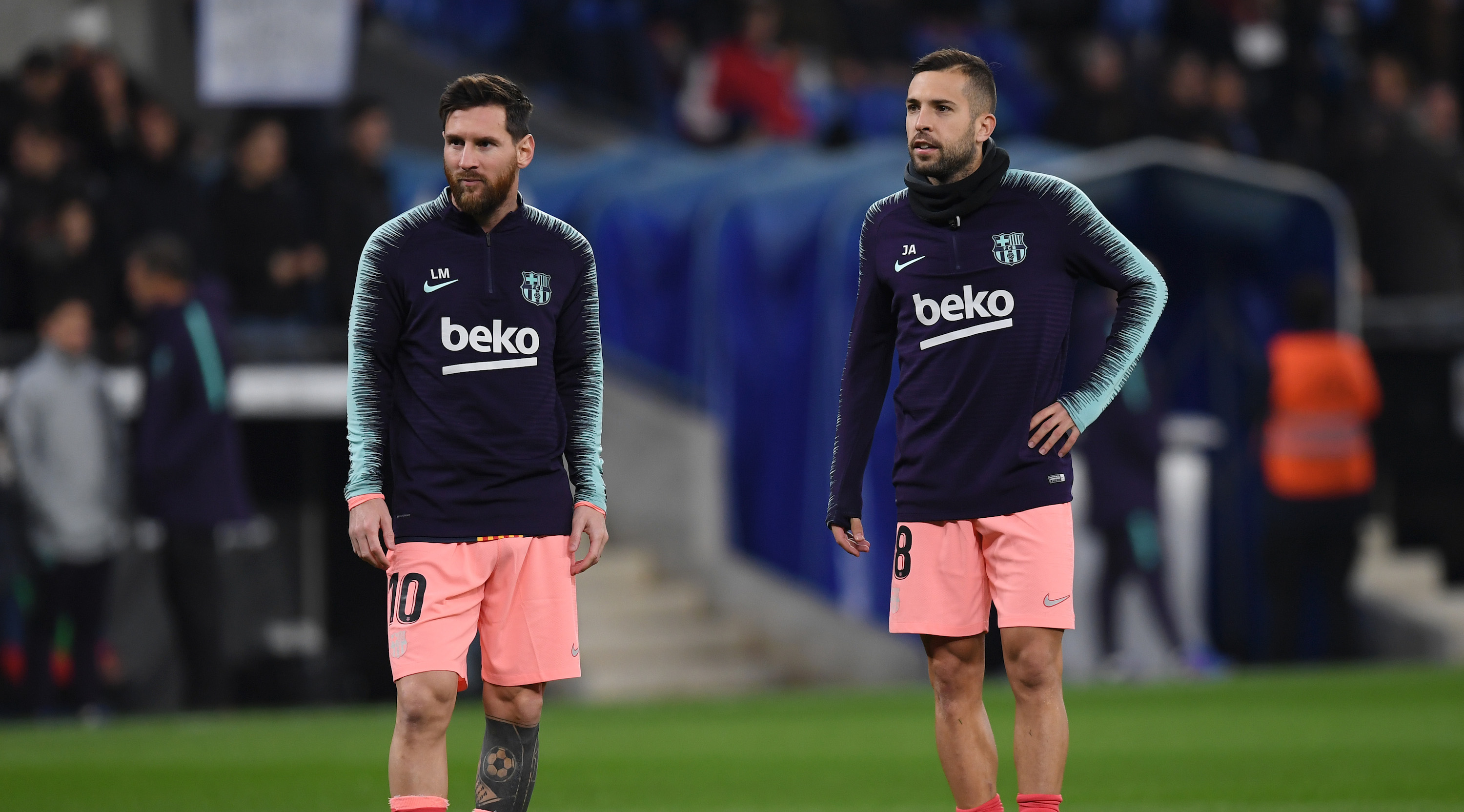 BARCELONA, SPAIN - DECEMBER 08: Lionel Messi of Barcelona and Jordi Alba of Barcelona look on as they warm up prior to the La Liga match between RCD Espanyol and FC Barcelona at RCDE Stadium on December 8, 2018 in Barcelona, Spain. (Photo by Alex Caparros/Getty Images)