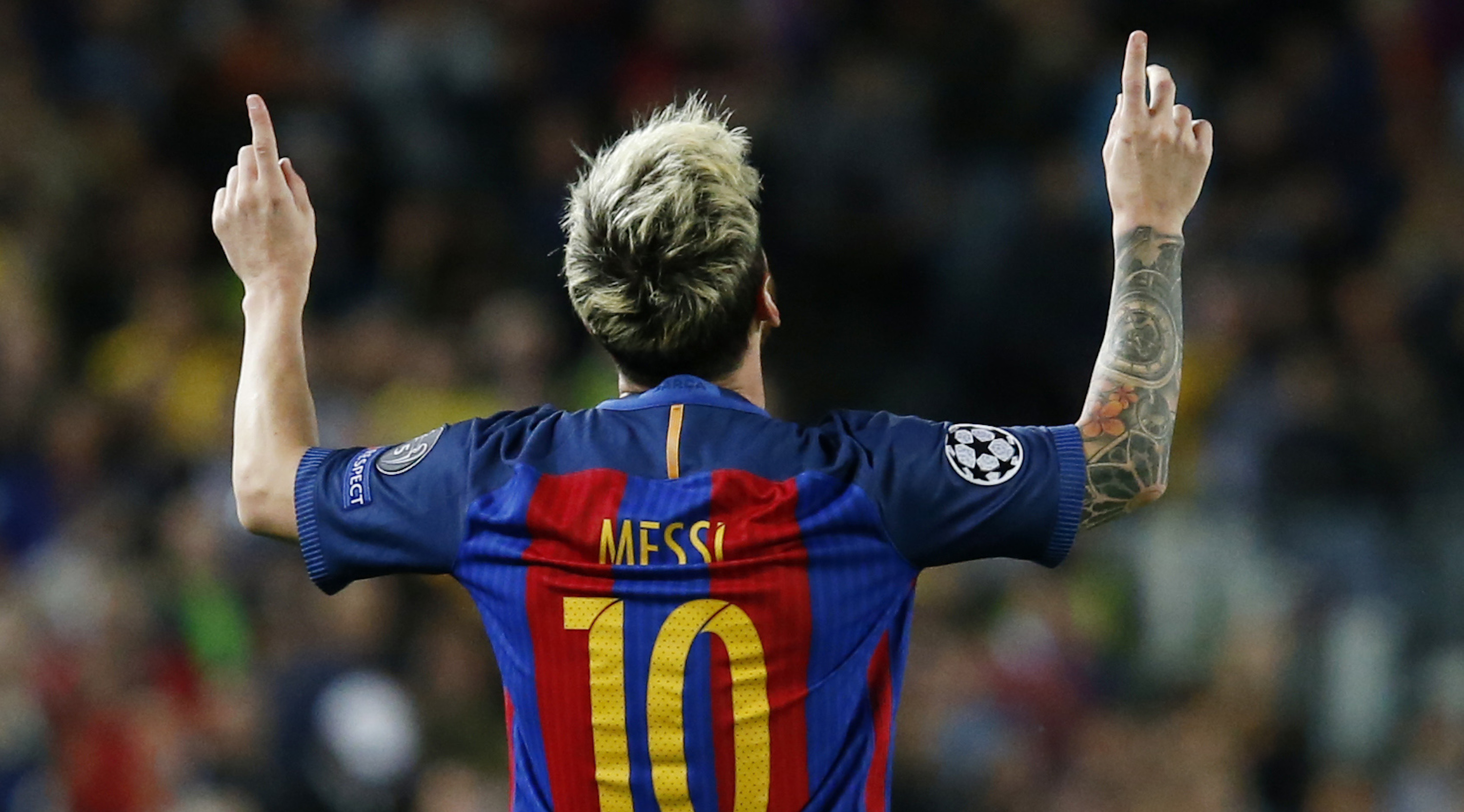 Barcelona's Argentinian forward Lionel Messi celebrates a goal during the UEFA Champions League football match FC Barcelona vs Manchester City at the Camp Nou stadium in Barcelona on October 19, 2016. / AFP / PAU BARRENA (Photo credit should read PAU BARRENA/AFP/Getty Images)