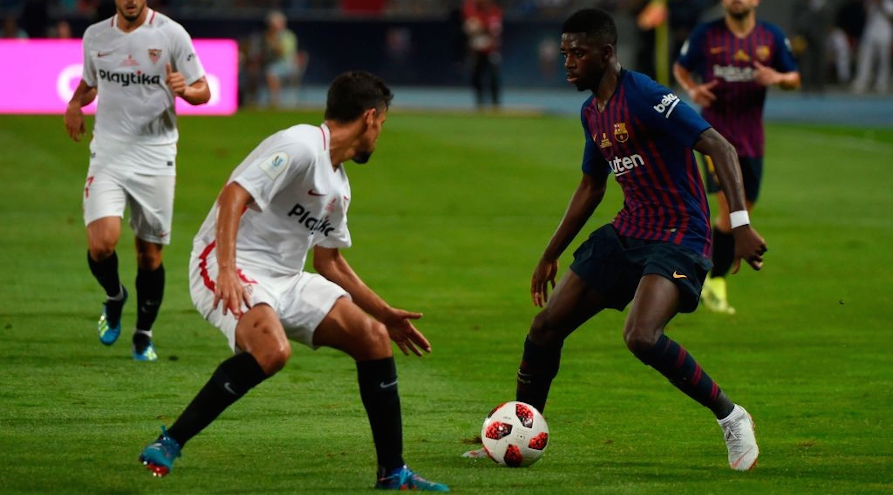 Sevilla's Spanish midfielder Jesus Navas (L) vies with Barcelona's French forward Ousmane Dembele during the Spanish Super Cup final between Sevilla and FC Barcelona at Ibn Batouta stadium in the Moroccan city of Tangiers on August 12, 2018. (Photo by FADEL SENNA / AFP) (Photo credit should read FADEL SENNA/AFP/Getty Images)