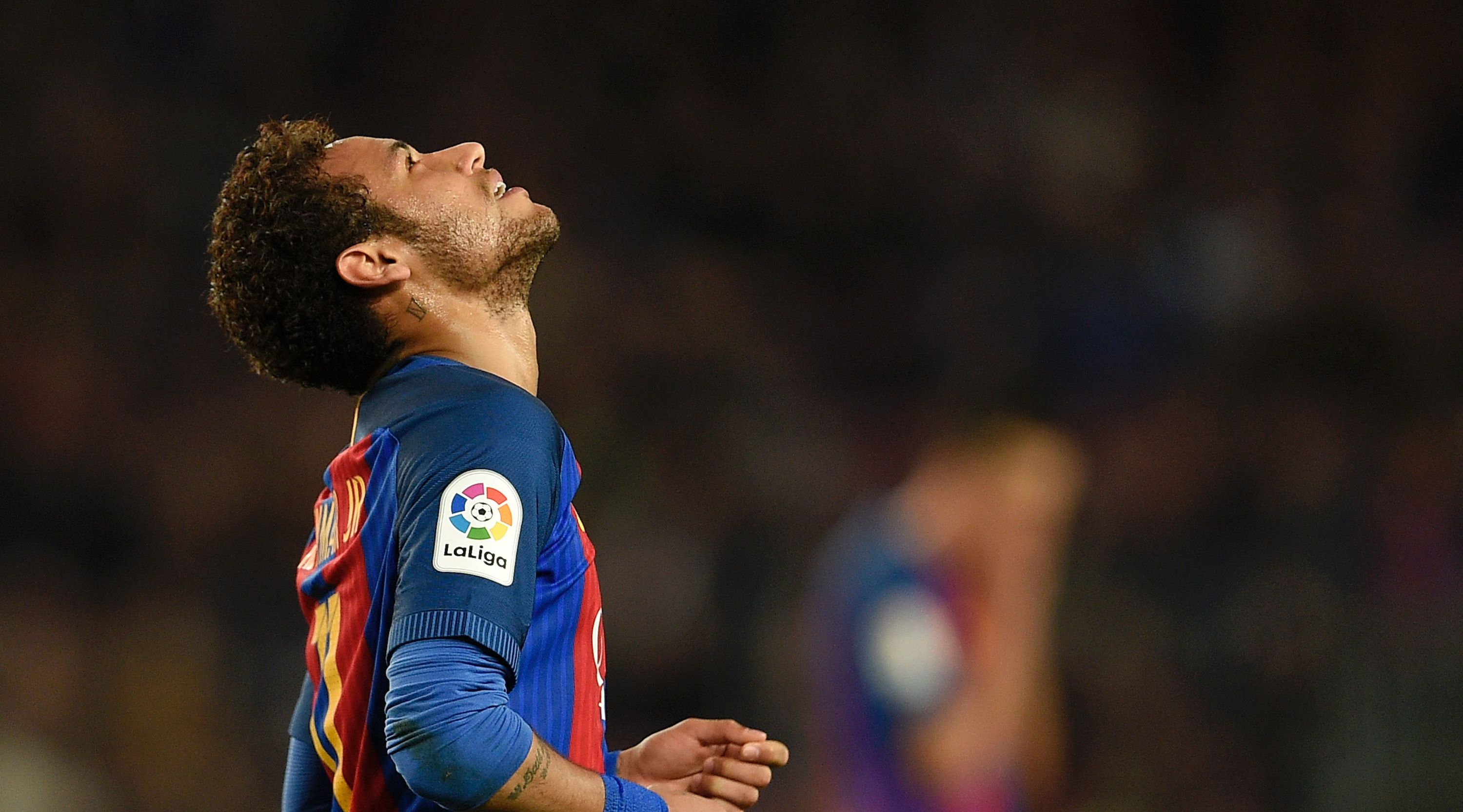 Barcelona's Brazilian forward Neymar looks skywards during the Spanish league football match FC Barcelona vs Valencia CF at the Camp Nou stadium in Barcelona on March 19, 2017. / AFP PHOTO / LLUIS GENE (Photo credit should read LLUIS GENE/AFP/Getty Images)