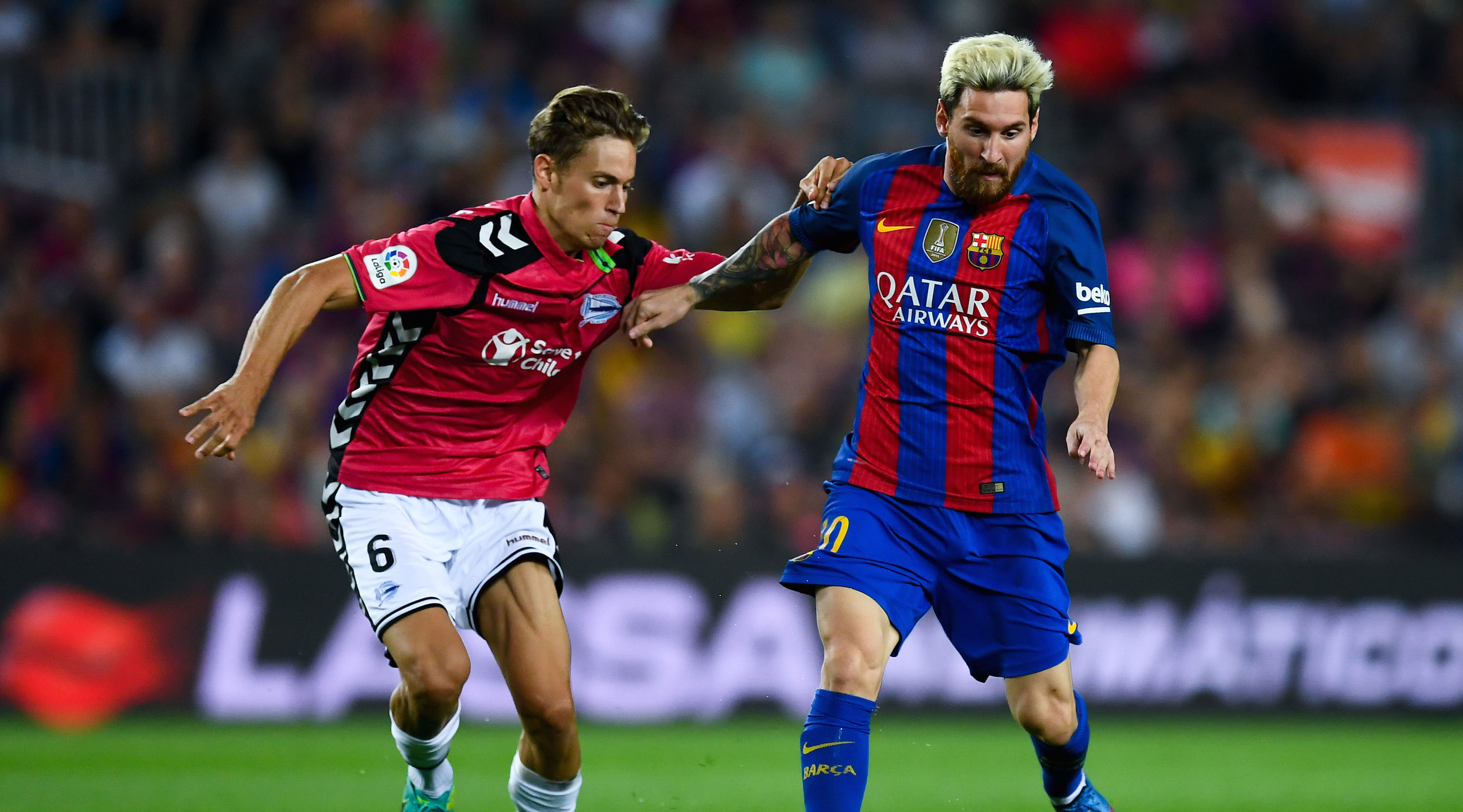 BARCELONA, SPAIN - SEPTEMBER 10: Lionel Messi of FC Barcelona competes for the ball with Marcos Llorente of Deportivo Alaves during the La Liga match between FC Barcelona and Deportivo Alaves at Camp Nou stadium on September 10, 2016 in Barcelona, Spain. (Photo by David Ramos/Getty Images)