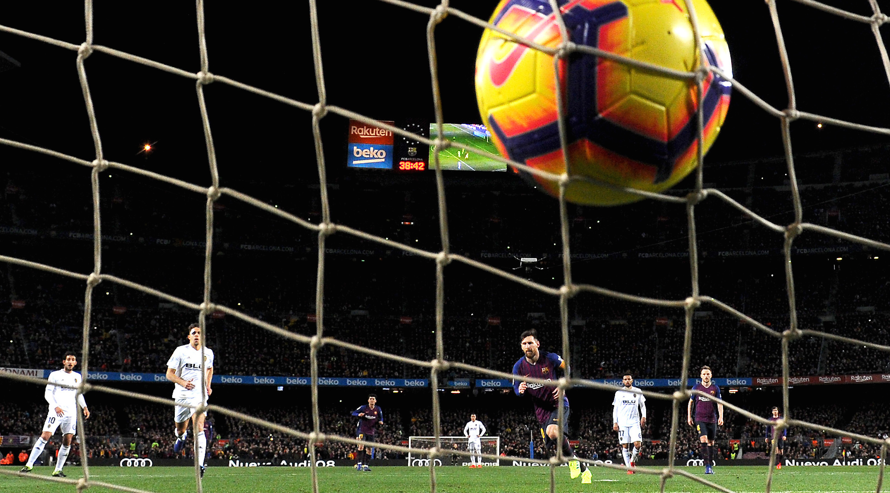 Lionel Messi of Barcelona scores his team's first goal during the La Liga match between FC Barcelona and Valencia CF at Camp Nou on February 2, 2019 in Barcelona, Spain. (Photo by Alex Caparros/Getty Images)