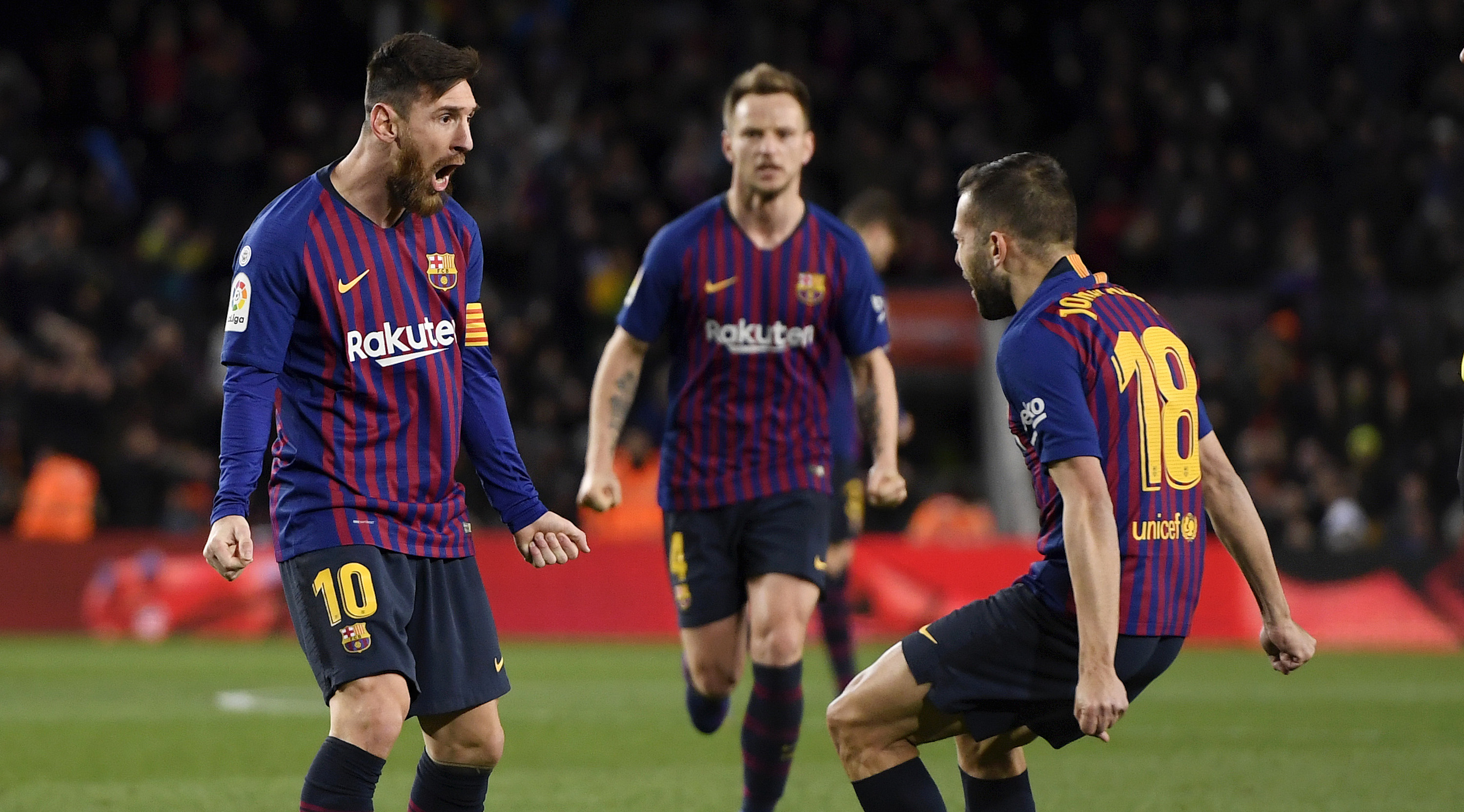 Lionel Messi of Barcelona celebrates with teammates Jordi Alba and Ivan Rakitic after scoring their team's second goal during the La Liga match between FC Barcelona and Valencia CF at Camp Nou on February 2, 2019 in Barcelona, Spain. (Photo by Alex Caparros/Getty Images)