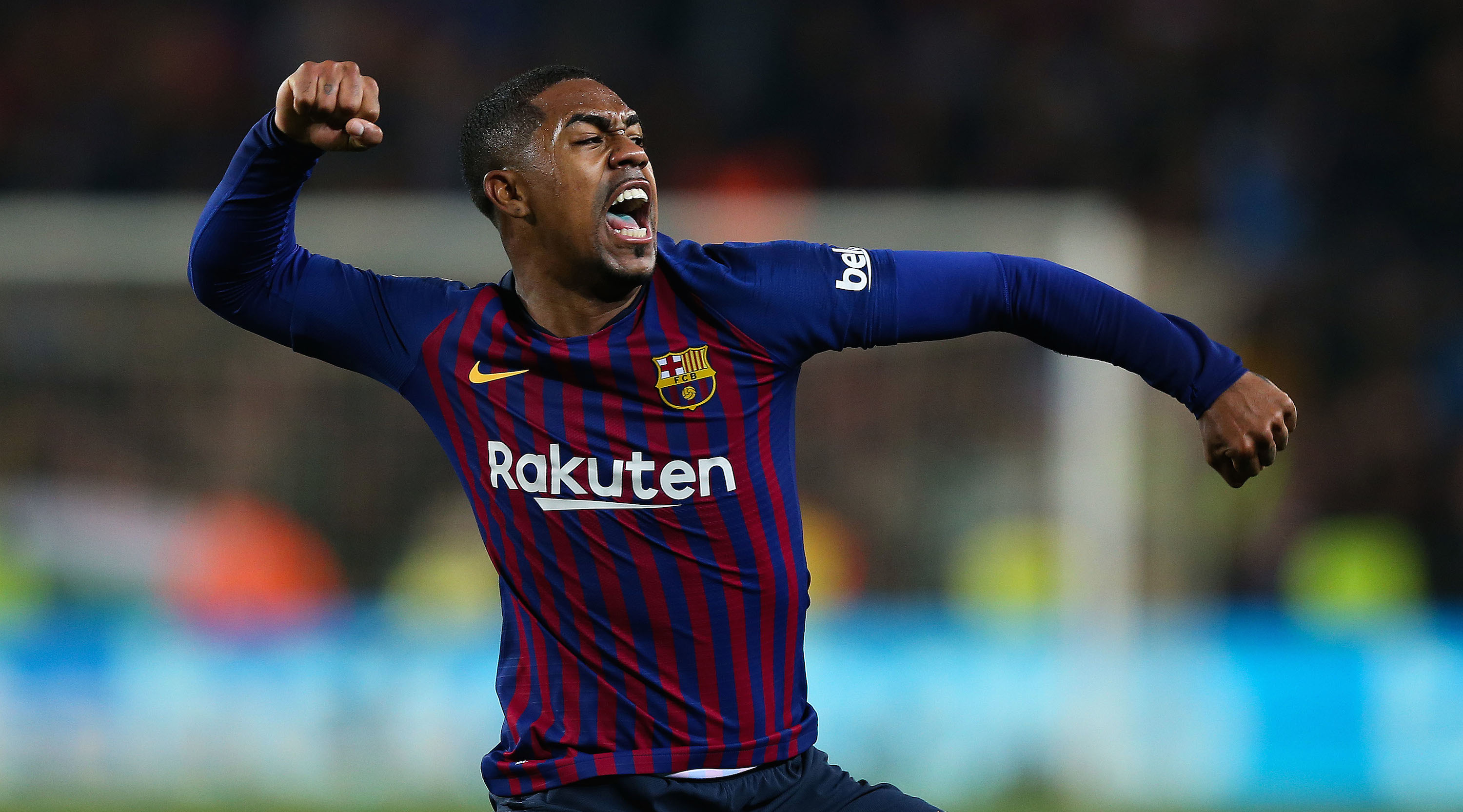 Malcom of FC Barcelona celebrates after scoring his team's first goal during the Copa del Semi Final first leg match between Barcelona and Real Madrid at Nou Camp on February 06, 2019 in Barcelona, Spain. (Photo by Angel Martinez/Getty Images)