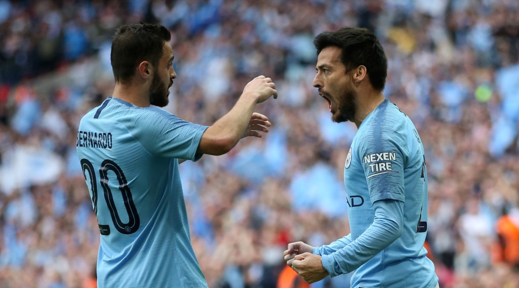 LONDON, ENGLAND - MAY 18: David Silva of Manchester City celebrates with teammate Bernardo Silva after scoring his team's first goal during the FA Cup Final match between Manchester City and Watford at Wembley Stadium on May 18, 2019 in London, England. (Photo by Alex Morton/Getty Images)