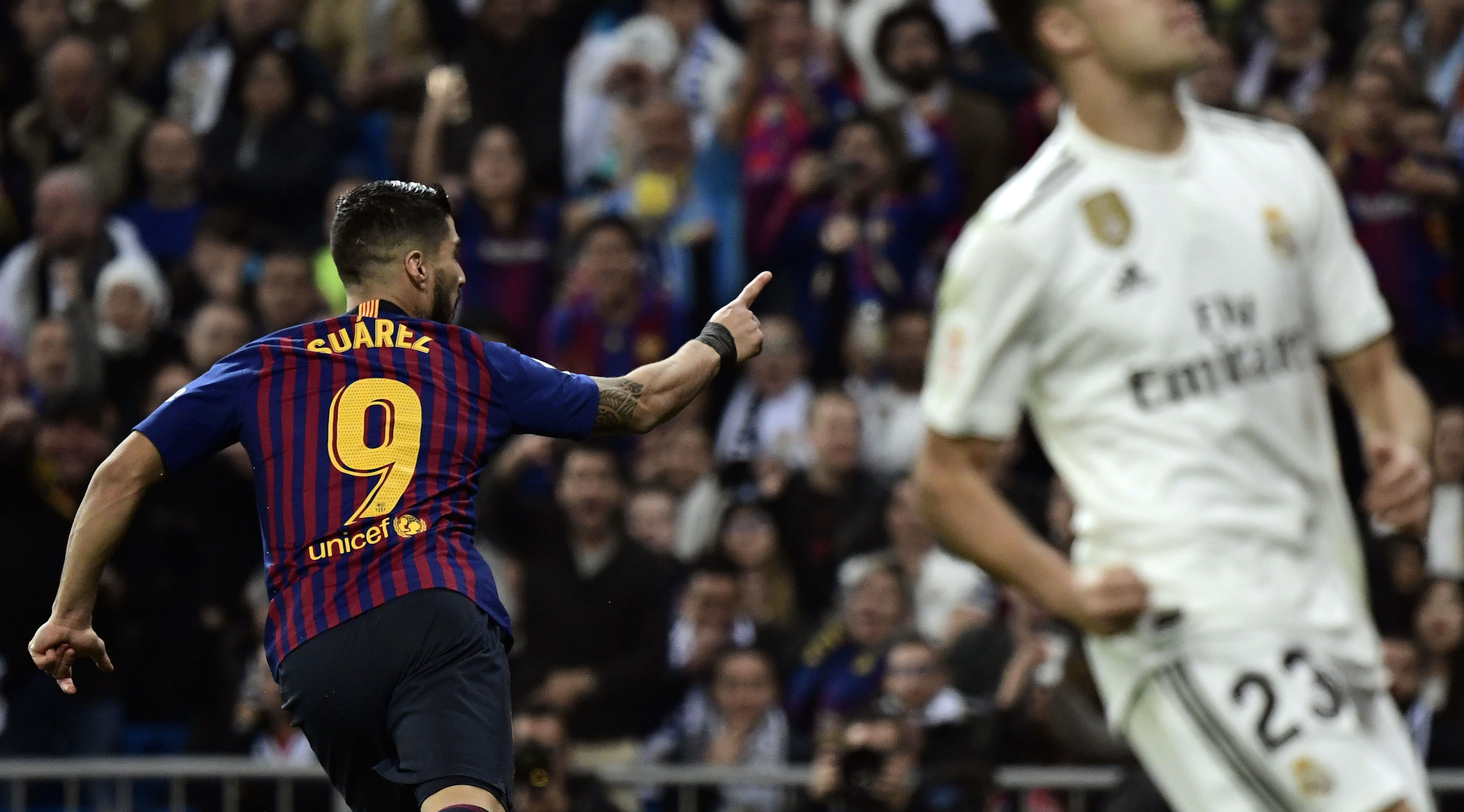 Barcelona's Uruguayan forward Luis Suarez celebrates his goal during the Spanish Copa del Rey (King's Cup) semi-final second leg football match between Real Madrid and Barcelona at the Santiago Bernabeu stadium in Madrid on February 27, 2019. (Photo by JAVIER SORIANO / AFP) (Photo credit should read JAVIER SORIANO/AFP/Getty Images)