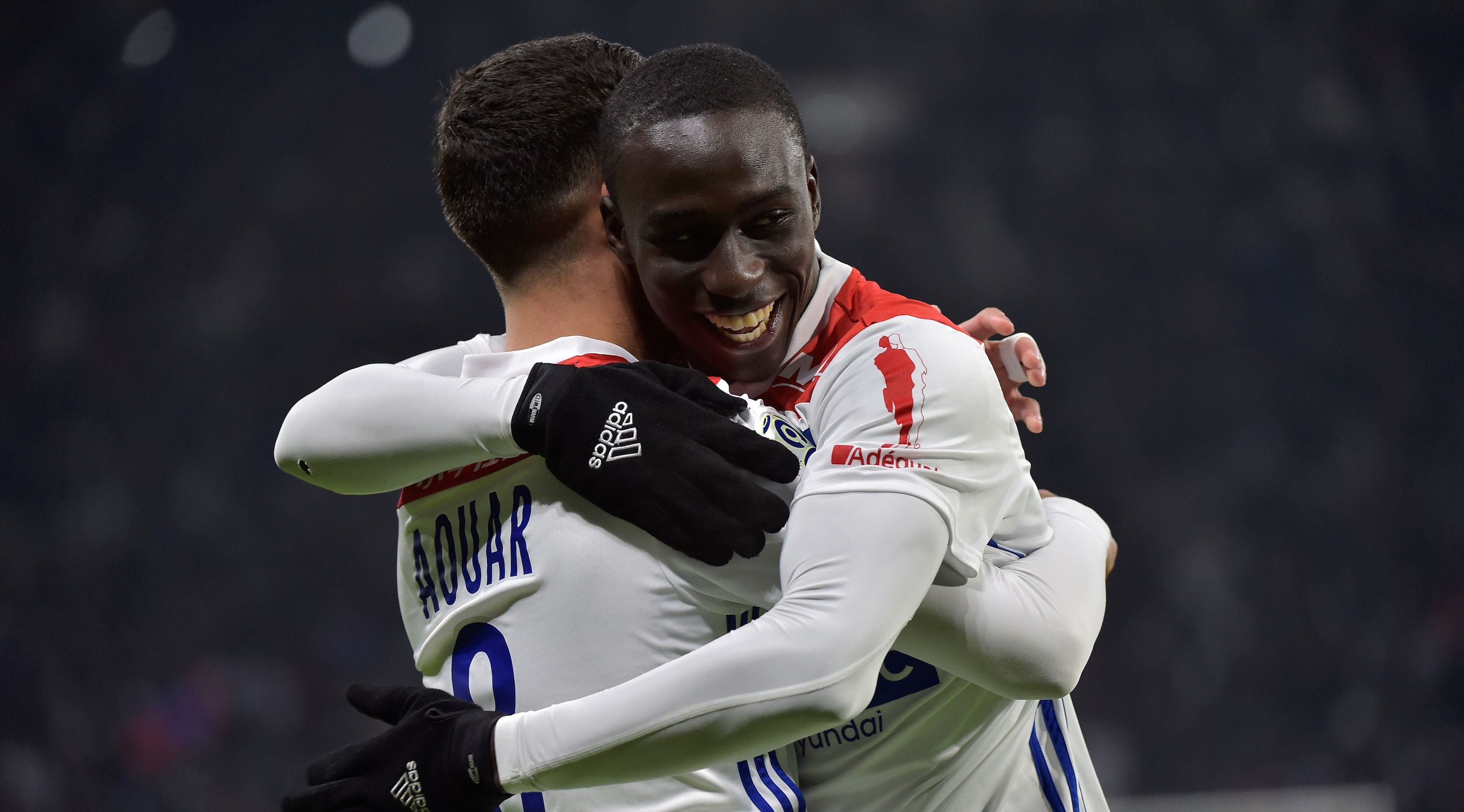 Lyon's French midfielder Houssem Aouar (L) celebrates after scoring a goal with Lyon's French defender Ferland Mendy (R) during the French L1 football match between Lyon (OL) and Monaco (ASM) on December 16, 2018, at the Groupama Stadium in Decines-Charpieu near Lyon, central-eastern France. (Photo by ROMAIN LAFABREGUE / AFP) (Photo credit should read ROMAIN LAFABREGUE/AFP/Getty Images)