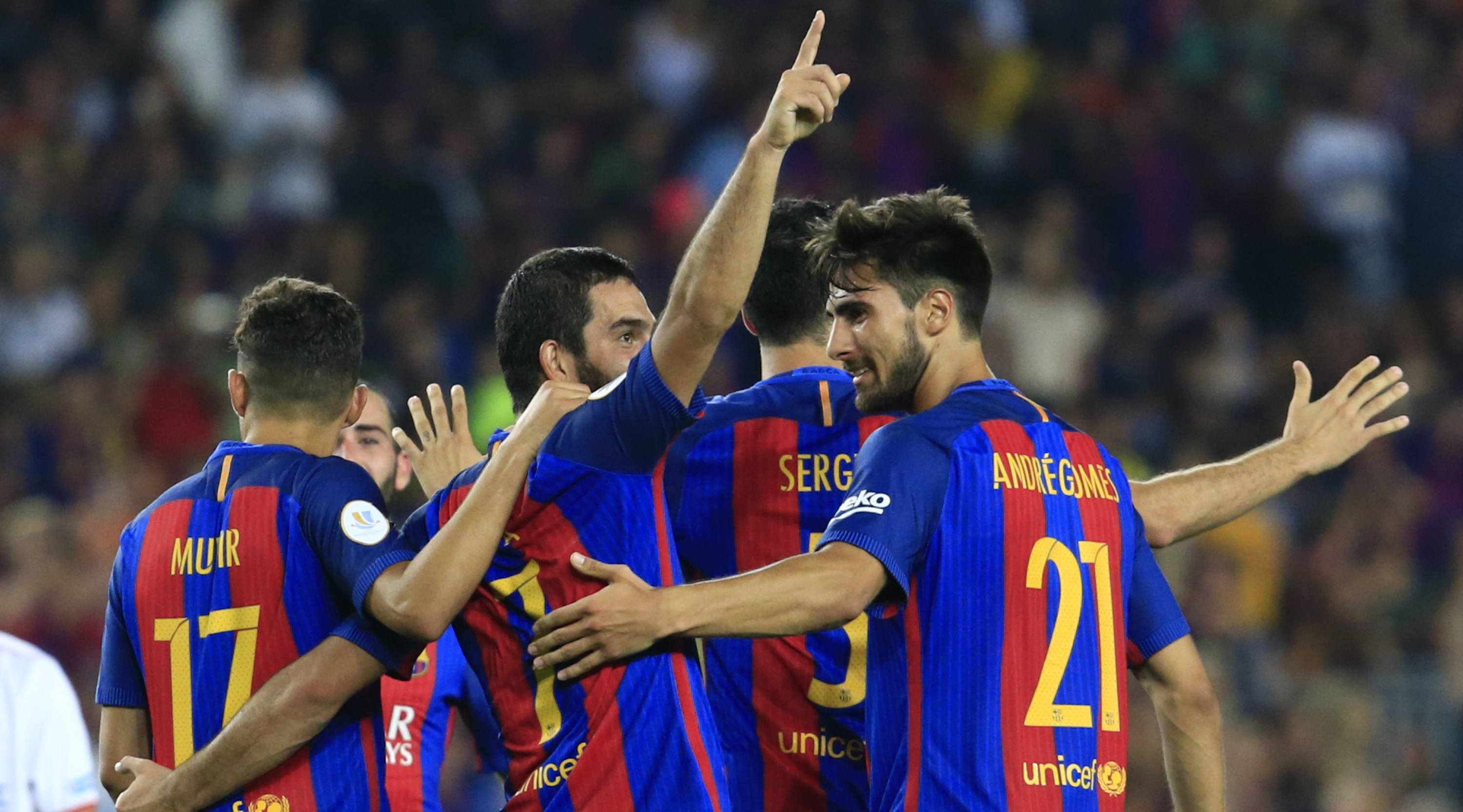 Barcelona's Turkish midfielder Arda Turan celebrates with teammates after scoring during the second leg of the Spanish Supercup football match between FC Barcelona and Sevilla FC at the Camp Nou stadium in Barcelona on August 17, 2016. / AFP / PAU BARRENA (Photo credit should read PAU BARRENA/AFP/Getty Images)
