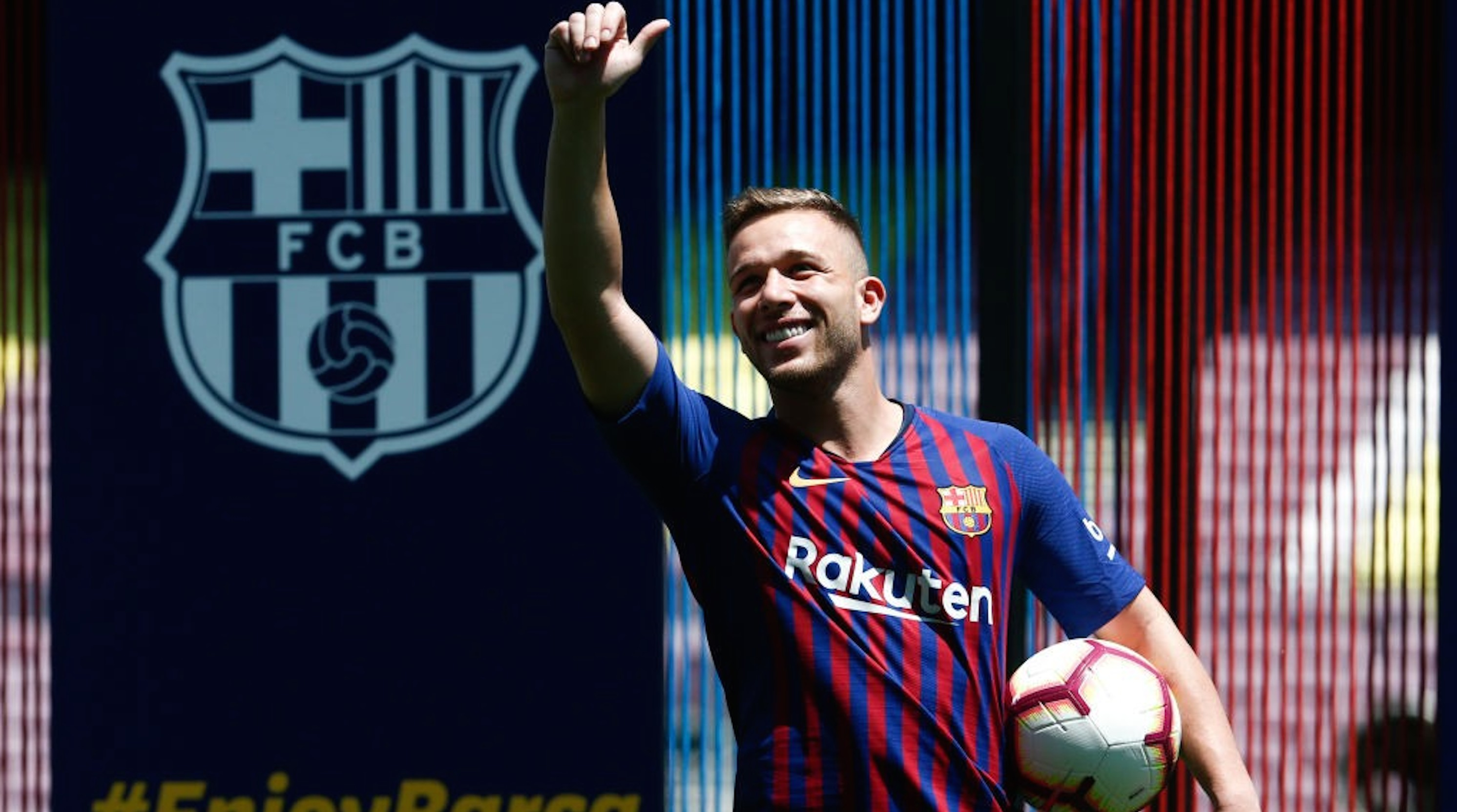 Barcelona's new player Brazilian midfielder Arthur Henrique Ramos de Oliveira Melo waves during his official presentation at the Camp Nou Stadium in Barcelona, on July 12, 2018. - Barcelona confirmed the arrival of Brazilian new recruit Arthur from Brazilian outfit Gremio on a 31 million euros ($37 million) deal. The Spanish champions will pay an extra 9 million in bonuses in the six-year deal struck with the Brazilians for the midfielder. (Photo by PAU BARRENA / AFP) (Photo credit should read PAU BARRENA/AFP/Getty Images)