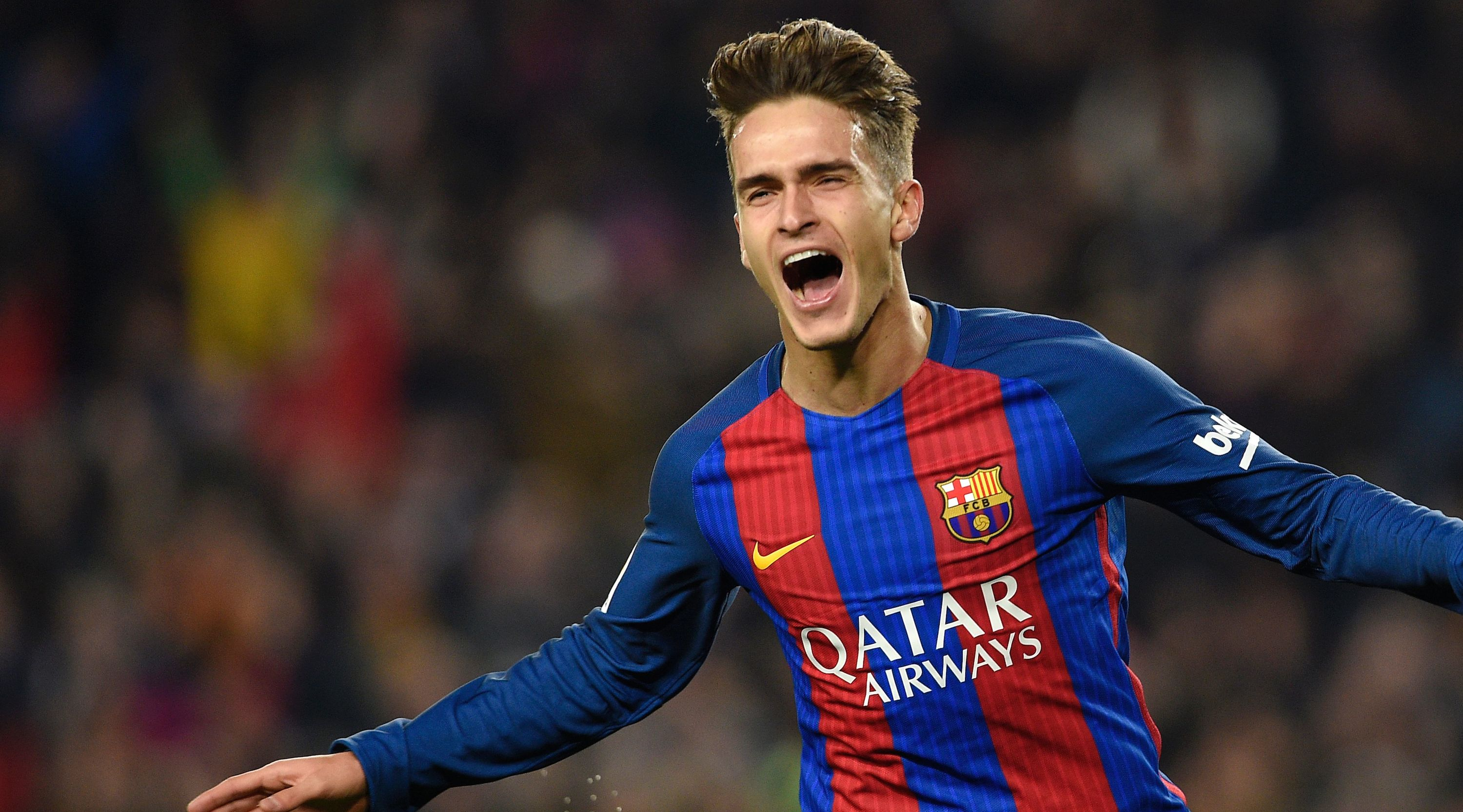 Barcelona's midfielder Denis Suarez celebrates after scoring the opener during the Spanish Copa del Rey (King's Cup) quarter final second leg football match FC Barcelona vs Real Sociedad at the Camp Nou stadium in Barcelona on January 26, 2017. / AFP / LLUIS GENE (Photo credit should read LLUIS GENE/AFP/Getty Images)