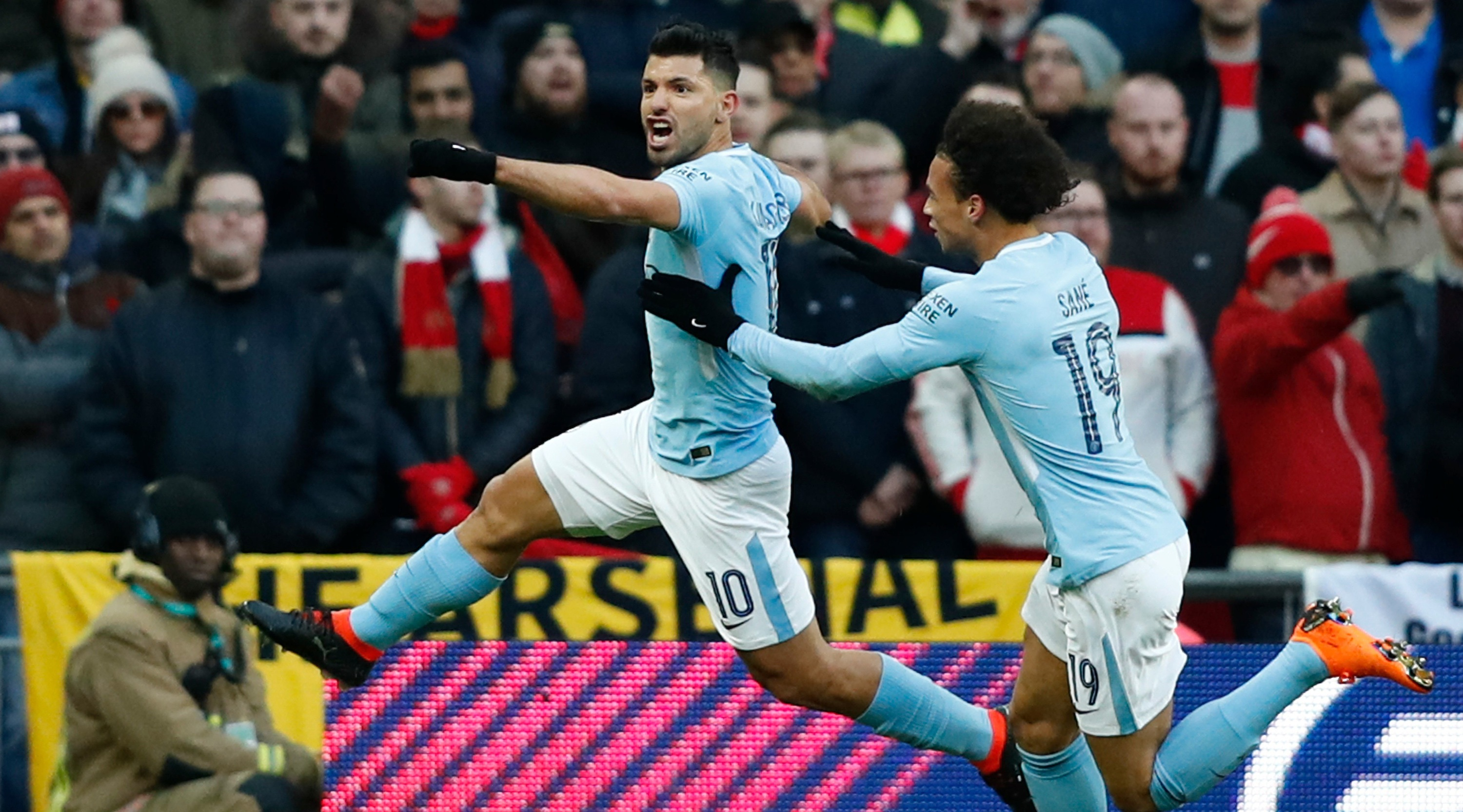 Manchester City's Argentinian striker Sergio Aguero celebrates with Manchester City's German midfielder Leroy Sane (R) after scoring the opening goal during the English League Cup final football match between Manchester City and Arsenal at Wembley stadium in north London on February 25, 2018. / AFP PHOTO / Adrian DENNIS / RESTRICTED TO EDITORIAL USE. No use with unauthorized audio, video, data, fixture lists, club/league logos or 'live' services. Online in-match use limited to 75 images, no video emulation. No use in betting, games or single club/league/player publications. / (Photo credit should read ADRIAN DENNIS/AFP/Getty Images)