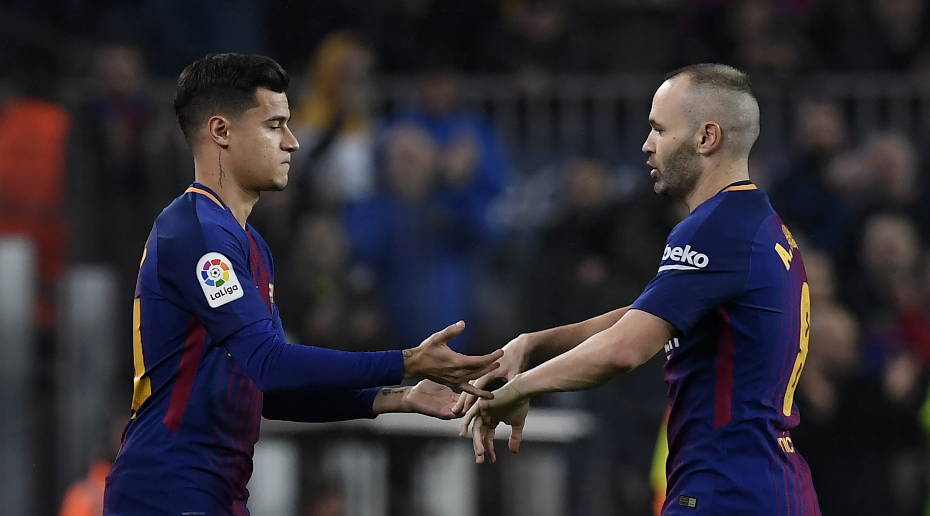 Barcelona's Brazilian midfielder Philippe Coutinho (L) replaces Barcelona's Spanish midfielder Andres Iniesta during the Spanish 'Copa del Rey' (King's cup) quarter-final second leg football match between FC Barcelona and RCD Espanyol at the Camp Nou stadium in Barcelona on January 25, 2018. / AFP PHOTO / LLUIS GENE (Photo credit should read LLUIS GENE/AFP/Getty Images)
