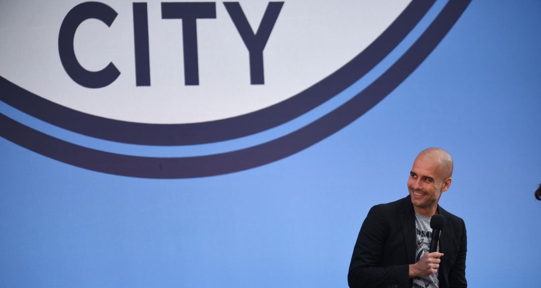 TOPSHOT - Spanish football manager Pep Guardiola speaks to Manchester City fans as he is officially unveiled as the club's new manager at the City Football Academy in Manchester, north west England on July 3, 2016. / AFP / OLI SCARFF (Photo credit should read OLI SCARFF/AFP/Getty Images)
