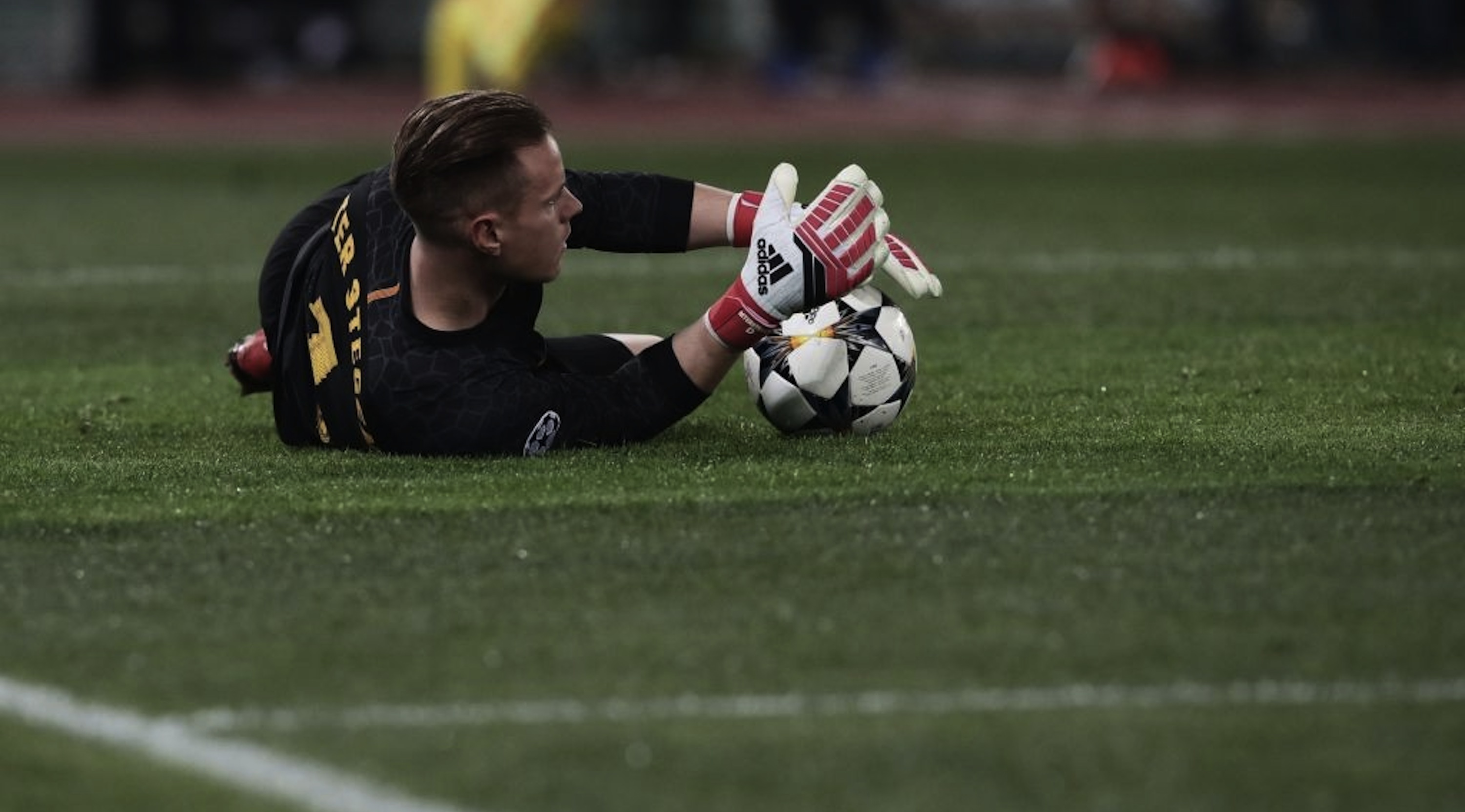 FC Barcelona's German goalkeeper Marc-Andre ter Stegen catches the ball during the UEFA Champions League quarter-final second leg football match between AS Roma and FC Barcelona at the Olympic Stadium in Rome on April 10, 2018. / AFP PHOTO / Isabella BONOTTO (Photo credit should read ISABELLA BONOTTO/AFP/Getty Images)