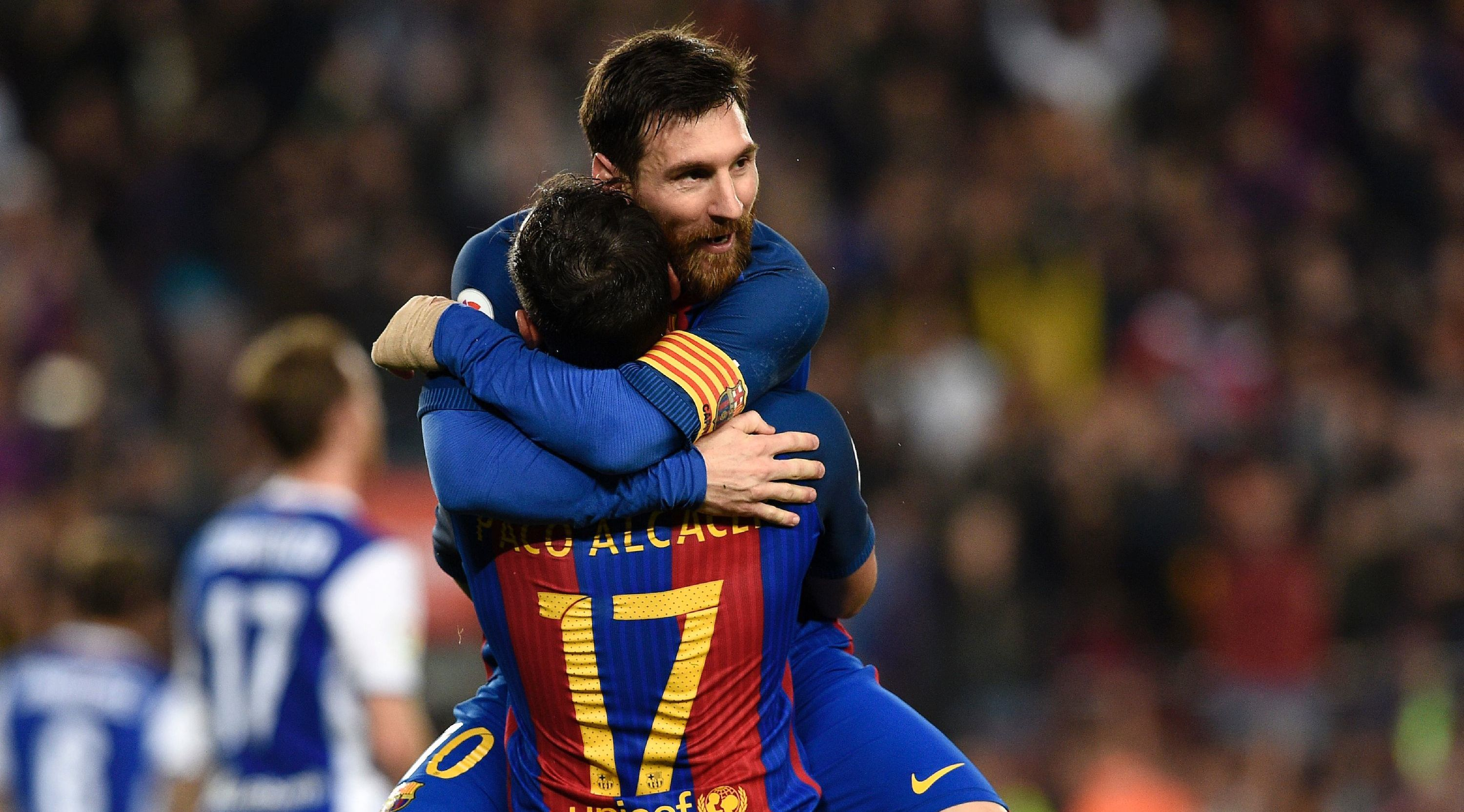 Barcelona's forward Paco Alcacer (bottom) celebrates a goal with Barcelona's Argentinian forward Lionel Messi during the Spanish league football match FC Barcelona vs Real Sociedad at the Camp Nou stadium in Barcelona on April 15, 2017. / AFP PHOTO / LLUIS GENE (Photo credit should read LLUIS GENE/AFP/Getty Images)