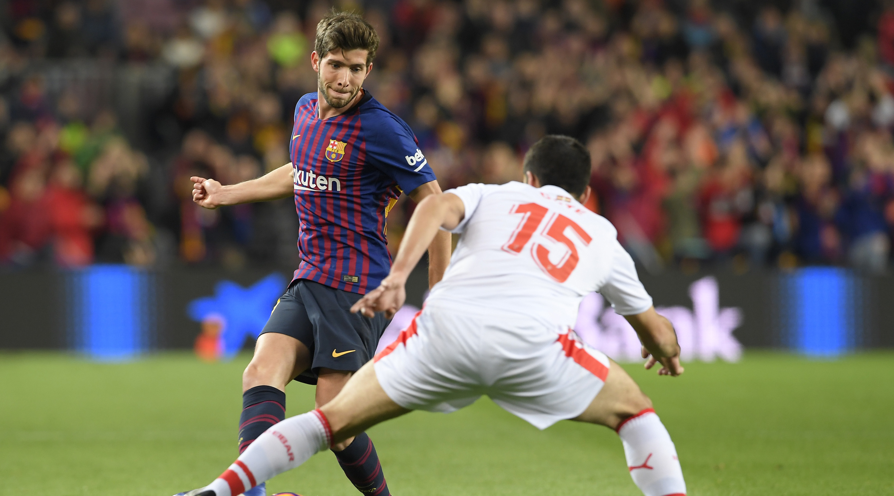 Barcelona's Spanish midfielder Sergi Roberto (L) vies with Eibar's Spanish defender Jose Angel during the Spanish League football match between FC Barcelona and SD Eibar at the Camp Nou stadium in Barcelona on January 13, 2019. (Photo by LLUIS GENE / AFP) (Photo credit should read LLUIS GENE/AFP/Getty Images)