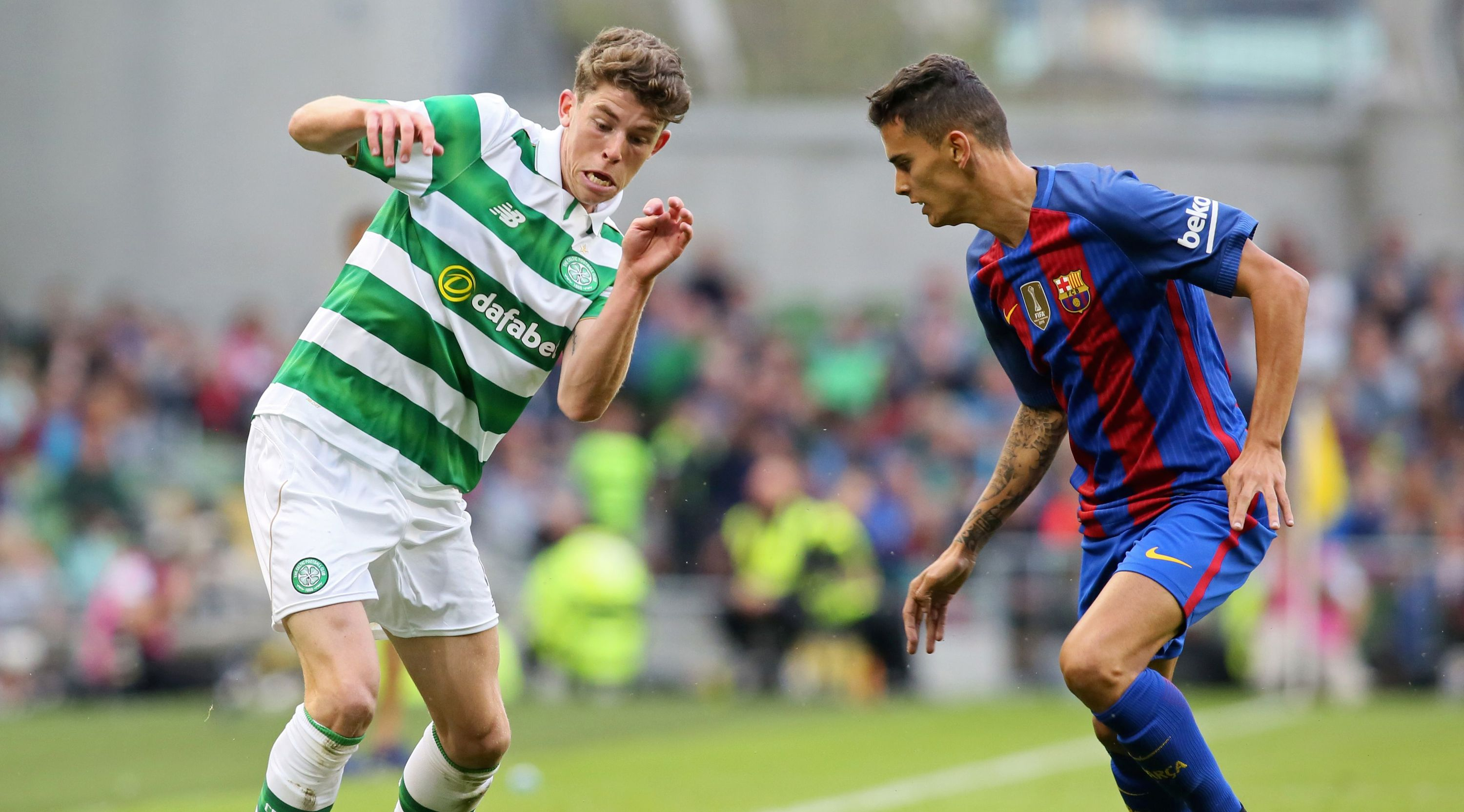 Celtic's Scottish midfielder Ryan Christie vies with Barcelona's Spanish defender Nili (R) during the pre-season International Champions Cup football match between Spanish champions, Barcelona and Scottish Premiership champions, Celtic at the Aviva Stadium in Dublin on July 30, 2016.