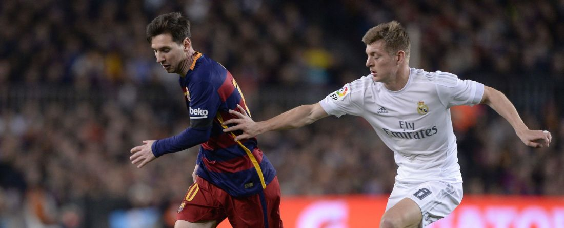 "Barcelona's Argentinian forward Lionel Messi (L) vies with Real Madrid's German midfielder Toni Kroos during the Spanish league ""Clasico"" football match FC Barcelona vs Real Madrid CF at the Camp Nou stadium in Barcelona on April 2, 2016. / AFP / JOSEP LAGO        (Photo credit should read JOSEP LAGO/AFP/Getty Images)"