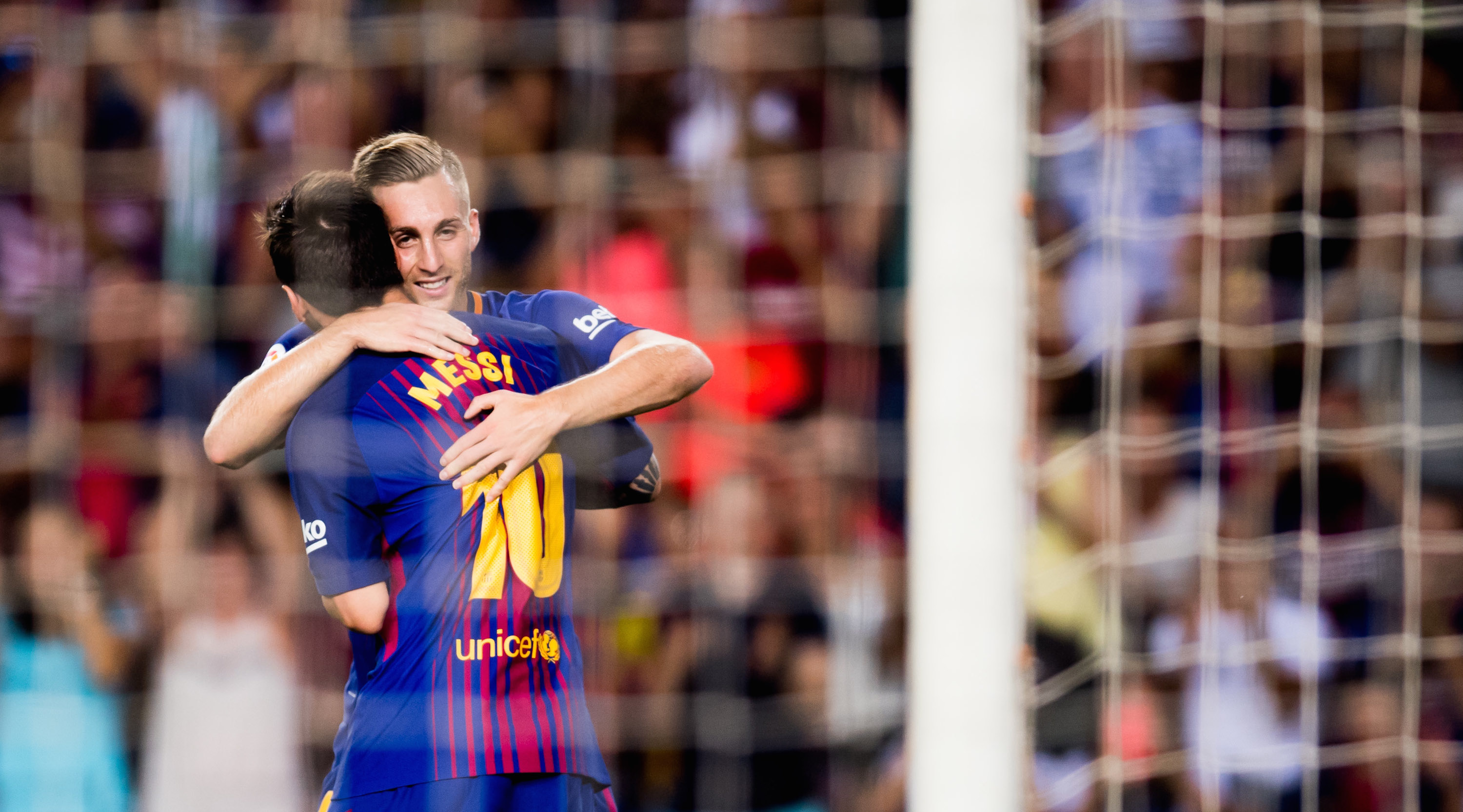 BARCELONA, SPAIN - AUGUST 07: Lionel Messi of FC Barcelona celebrates with his teammate Gerard Deulofeu (R) after scoring his team's third goal during the Joan Gamper Trophy match between FC Barcelona and Chapecoense at Camp Nou stadium on August 7, 2017 in Barcelona, Spain. (Photo by Alex Caparros/Getty Images)