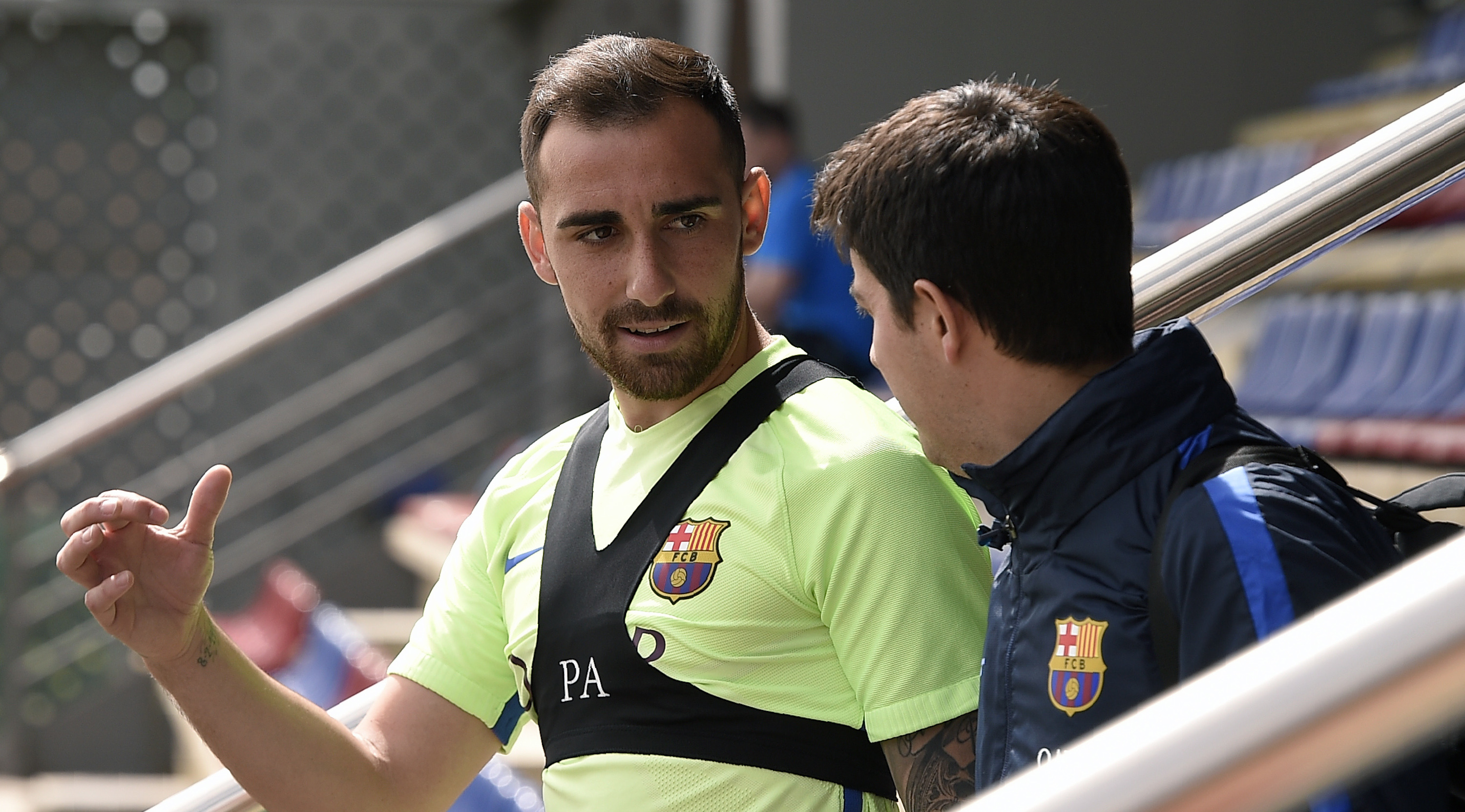 Barcelona's forward Paco Alcacer (L) chats with a teammate as he arrives for a training session at the Sports Center FC Barcelona Joan Gamper in Sant Joan Despi, near Barcelona on May 5, 2017 / AFP PHOTO / LLUIS GENE (Photo credit should read LLUIS GENE/AFP/Getty Images)