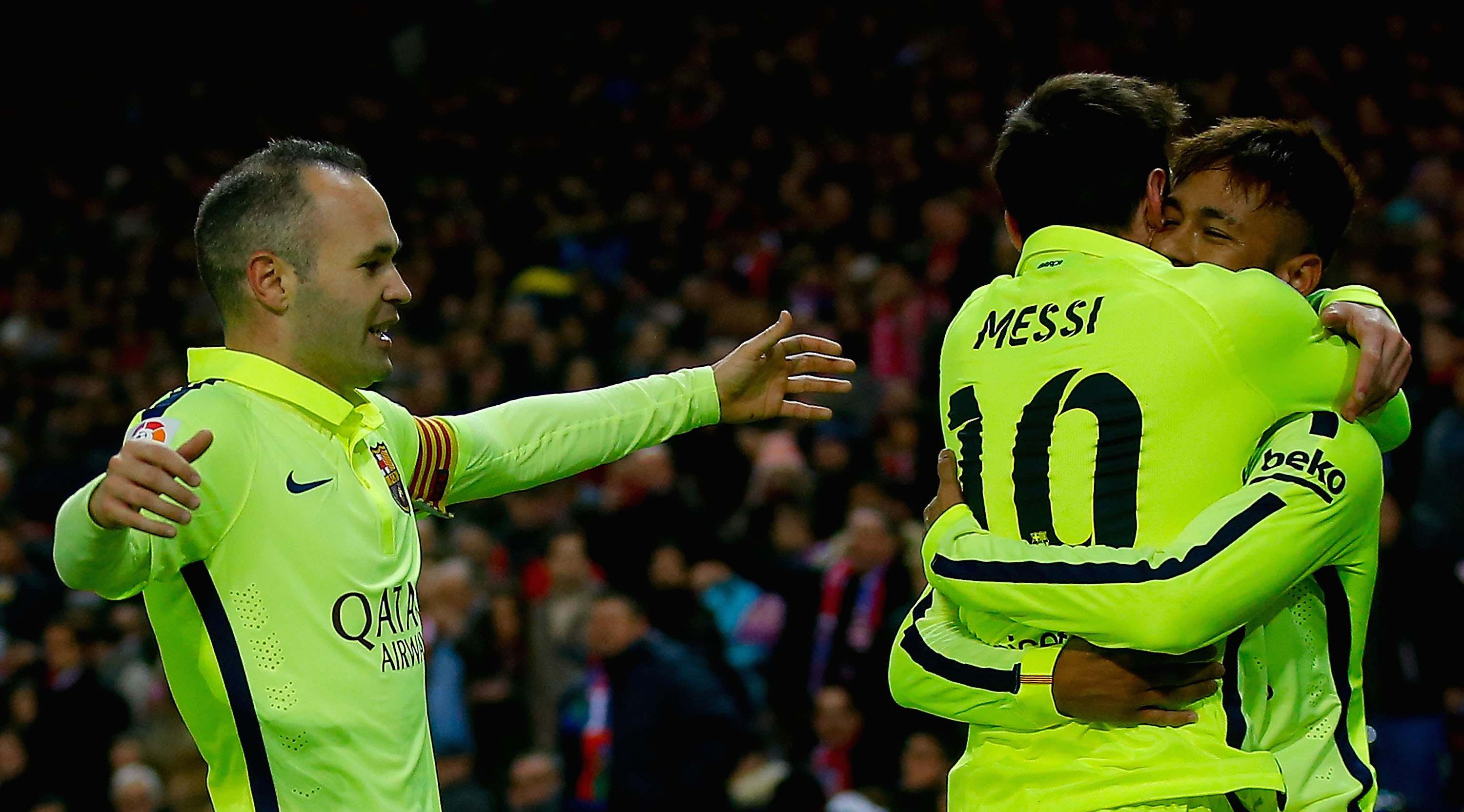 MADRID, SPAIN - JANUARY 28: Neymar JR. of FC Barcelona embraces his teammate Lionel Messi (2ndL) celebrating scoring their third goal as Andres Iniesta (L) approaches them during the Copa del Rey Round of 8 second leg match between Club Atletico de Madrid and FC Barcelona at Vicente Calderon Stadium on January 28, 2015 in Madrid, Spain. (Photo by Gonzalo Arroyo Moreno/Getty Images)